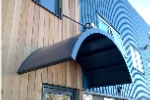 Curved entrance door canopy