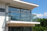 Modern balcony rail with square glass supports